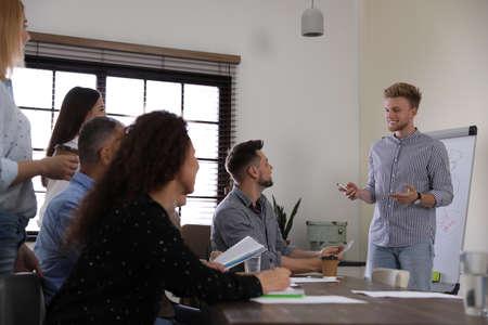 Portrait of volunteers having meeting in office 写真素材