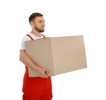 Young worker carrying box isolated on white. Moving service Zdjęcie Seryjne