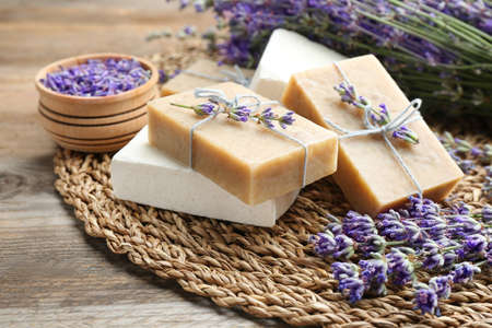 Handmade soap bars with lavender flowers on brown wooden table Stockfoto