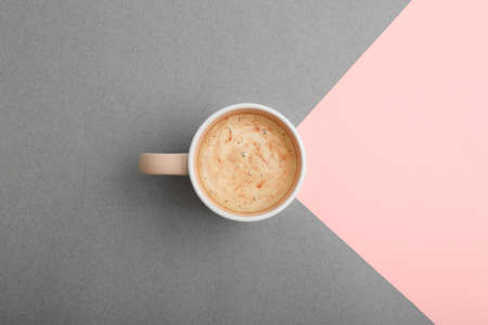 Cup of coffee on color background, top view 写真素材