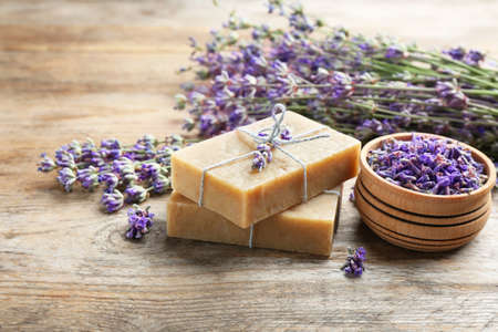 Handmade soap bars with lavender flowers on brown wooden table. Space for text 版權商用圖片