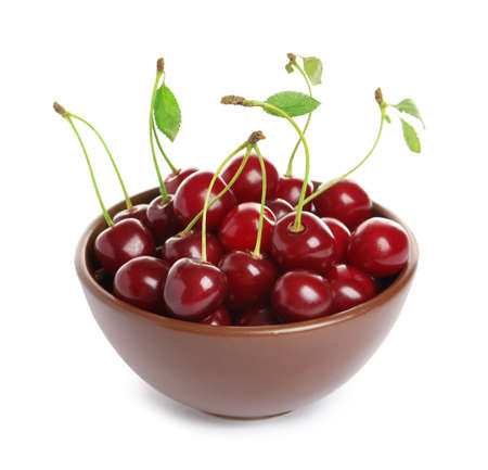 Ceramic bowl of delicious ripe sweet cherries on white background