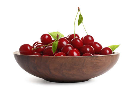 Wooden plate of delicious ripe sweet cherries on white background 写真素材