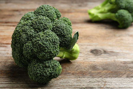 Fresh broccoli on wooden table, closeup with space for text 版權商用圖片