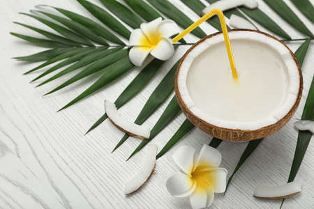 Composition with half of coconut on white wooden background Stok Fotoğraf
