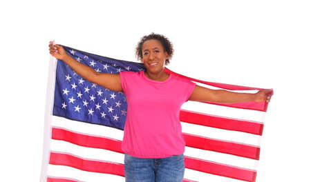 Portrait of happy African-American woman with USA flag on white background Stockfoto