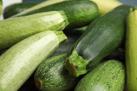 Fresh ripe green zucchini as background, closeup 版權商用圖片