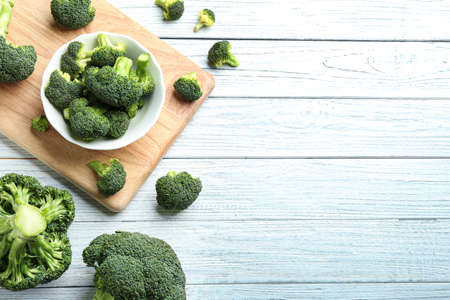 Flat lay composition of fresh green broccoli on white wooden table, space for text Stok Fotoğraf