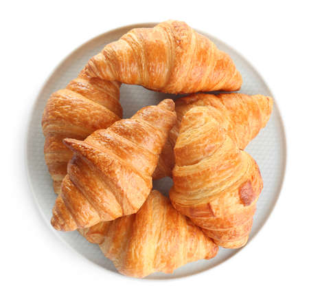 Plate with tasty croissants on white background, top view. French pastry