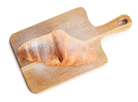 Wooden board with tasty croissant and powdered sugar on white background, top view. French pastry 版權商用圖片