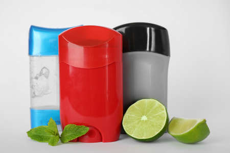 Different natural male deodorants,lime and mint on white background