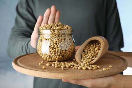 Man refusing to eat soy, closeup. Food allergy concept Stock Photo