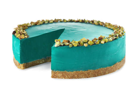 Delicious spirulina cheesecake decorated with pistachios isolated on white