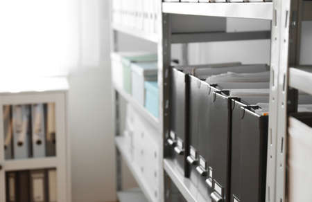 Folders with documents on shelf in archive. Space for text Stock fotó