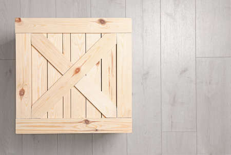Wooden crate on floor, top view. Space for text
