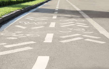 Bicycle lane with marking on asphalt road Фото со стока