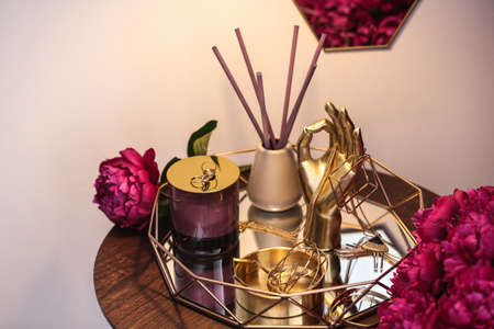 Composition with stylish accessories, flowers and interior elements on table indoors 版權商用圖片 - 128776531