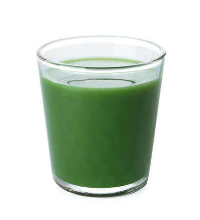 Glass of fresh wheat grass juice on white background