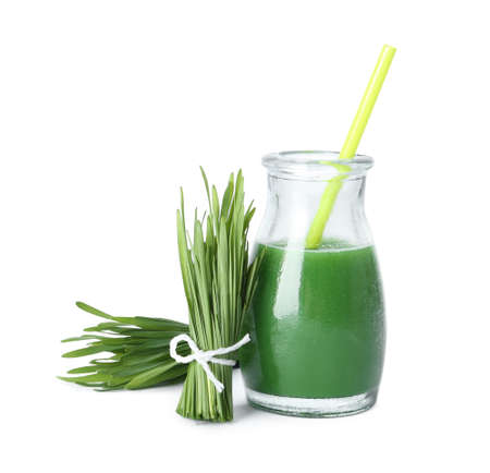 Bottle of wheat grass juice and sprouts on white background