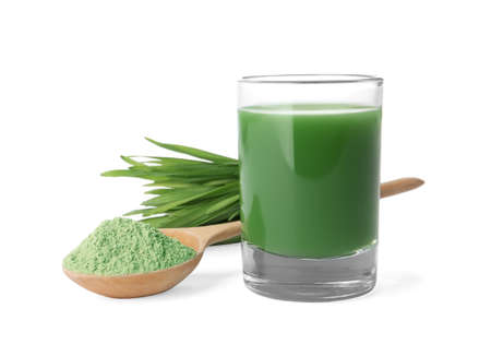 Glass of wheat grass juice, spoon with powder and sprouts on white background