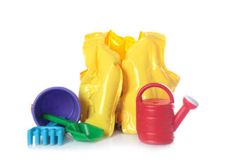 Inflatable vest and beach toys on white background