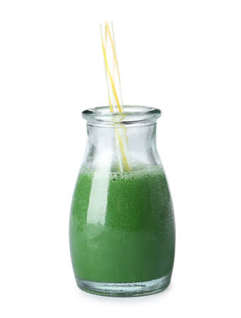 Fresh wheat grass juice and straw in glass bottle on white background Stock Photo