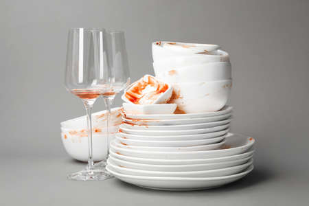 Set of dirty dishes on grey background Stock Photo