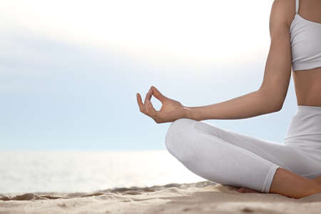 Young woman practicing zen meditation on beach, closeup. Space for text Фото со стока - 128780204