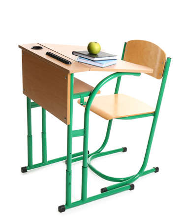 Wooden school desk with stationery and apple on white background Stockfoto