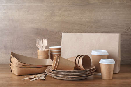 New paper dishware on wooden table. Eco life 写真素材