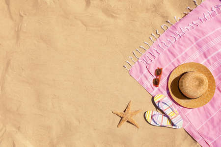 Flat lay composition with stylish beach accessories on sand. Space for text Фото со стока
