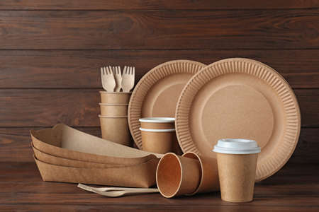 New paper dishware on dark wooden table. Eco life 写真素材