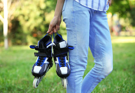 Woman with roller skates in summer park, closeup 版權商用圖片