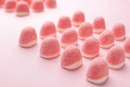 Sweet bright jelly candies on pink background
