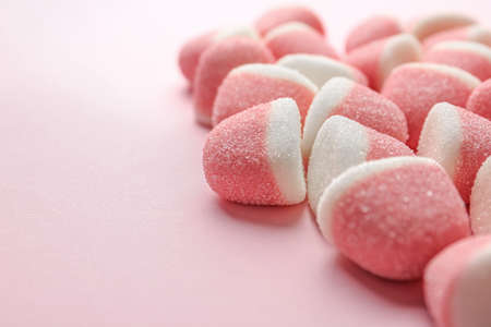 Closeup of sweet jelly candies on pink background. Space for text Stockfoto - 128780527