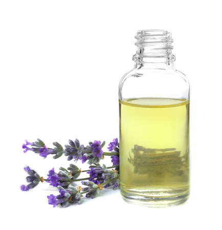 Bottle of essential oil and lavender flowers isolated on white Reklamní fotografie