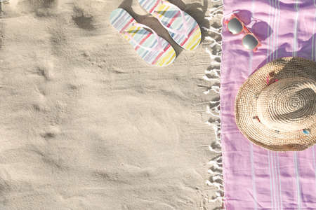 Flat lay composition with beach accessories on sand. Space for text Фото со стока