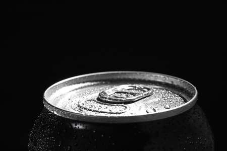Aluminum can of beverage covered with water drops on black background. Space for text 版權商用圖片