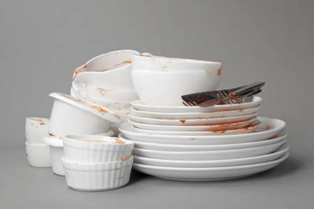 Set of dirty dishes on grey background 写真素材