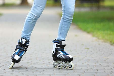 Woman roller skating on city street, closeup of legs 版權商用圖片