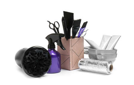 Set of professional hairdressers tools on white background
