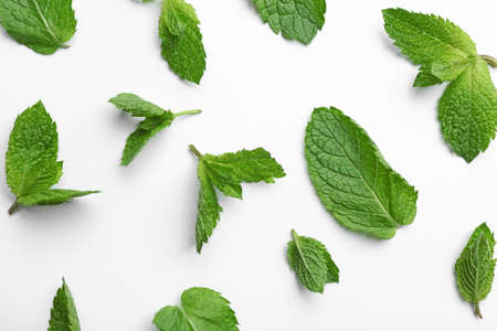 Fresh mint leaves on white background, flat lay