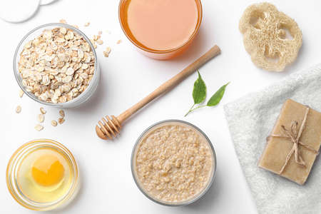 Composition of handmade face mask and ingredients on white background, top view