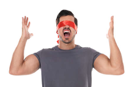 Emotional young man wearing red blindfold on white background