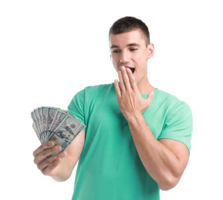 Handsome young man with dollars on white background