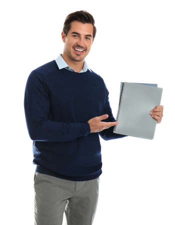 Young male teacher with notebooks on white background Stock Photo