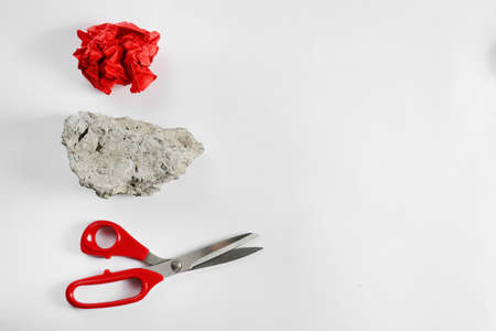Rock, paper and scissors on white background, top view
