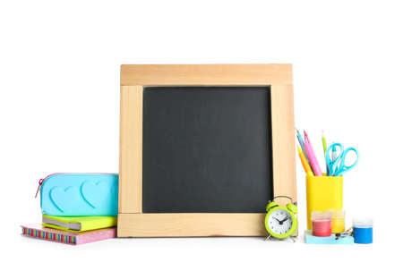 Different school stationery and small blank chalkboard on white background. Space for text