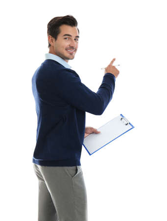 Young male teacher with clipboard on white background