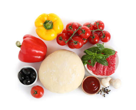 Fresh dough and ingredients for pizza on white background, top view